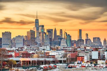 New York City, USA midtown Manhattan skyline at dusk from Brooklyn