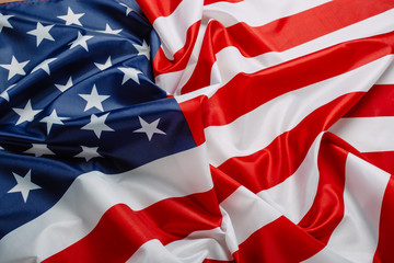 Flag of the United States of America closeup. Symbol of freedom and democracy. Independence day. American flag waving in the wind.