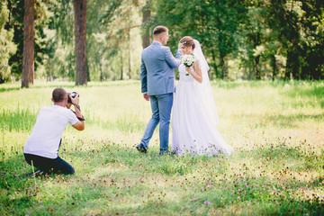Photographer makes a shooting dance