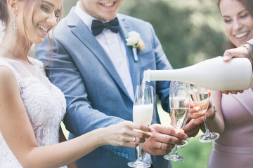 Hands with glasses of champagne, close-up