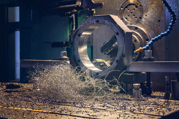 Processing of parts on a CNC boring machine, shavings lie on the machine.