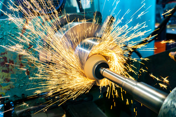 Grinding operations with an end abrasive wheel on a circular grinding machine with sparks.