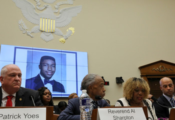 A picture is displayed of Garner while his mother Carr testifies during a U.S. House Judiciary Committee hearing on policing practices on Capitol Hill in Washington
