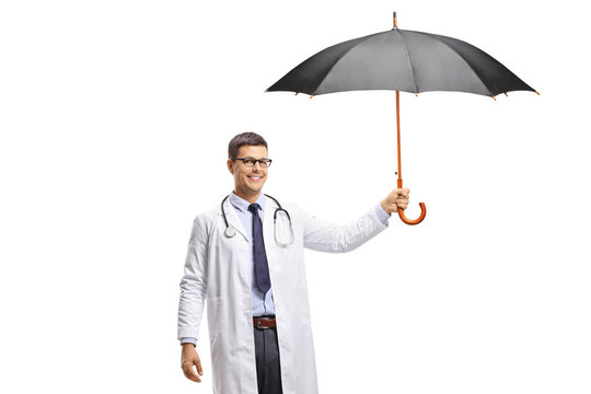 Young male doctor holding an open umbrella