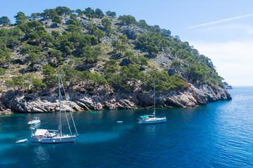 pleasure yachts in the Bay of Cala Murta on the island of Mallorca