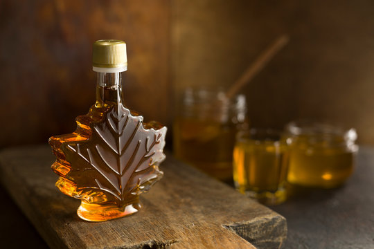 Maple Canadian syrup in a glass bottle.