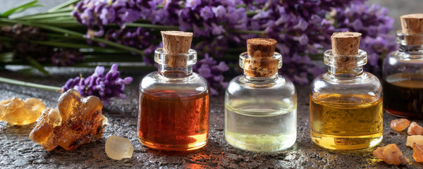 Panoramic header of essential oil bottles, frankincense and lavender