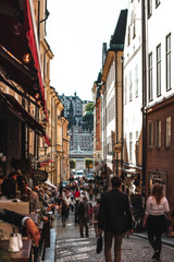 STOCKHOLM, SWEDEN - AUGUST 26, 2013: People walk along Tyska Brinken Street. Cozy cafes. Gamla Stan Old Town View