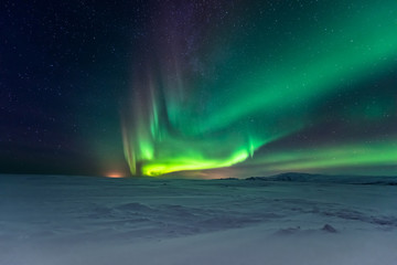 Foto op Aluminium Noorderlicht Northern lights aurora borealis in the winter