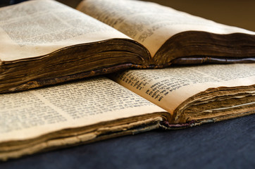 Jewish Bible. An open old Jewish books. Opened scripture pages. Selective focus. Closeup of hebrew text