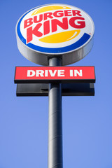 TROISDORF, GERMANY - January 21, 2017: Burger King signpost against blue sky.  Burger King is the second largest chain of hamburger fast food restaurants in terms of global locations.