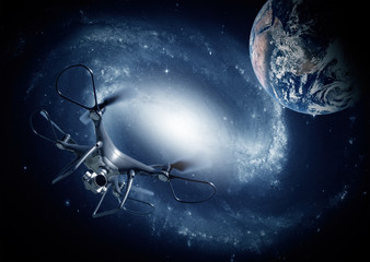 Dark drone explores space against the background of the galaxy and planet Earth. Elements of this image furnished by NASA.