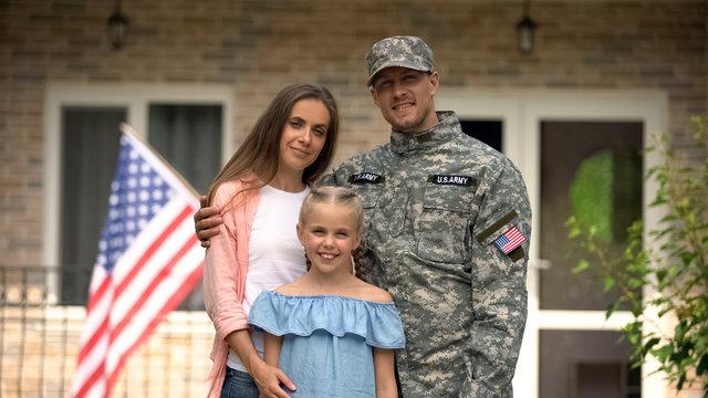 Happy american patriots family looking at camera, social insurance for veterans