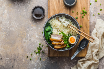 Delicious ramen soup with pork, egg and bok choy, copy space
