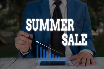 Handwriting text writing Summer Sale. Conceptual photo Annual discount events that takes place during summer season Male human wear formal work suit presenting presentation using smart device