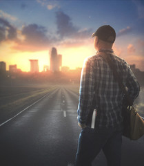 Man walking to city with Bible