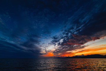 Beautiful sunset in blue tones over the sea