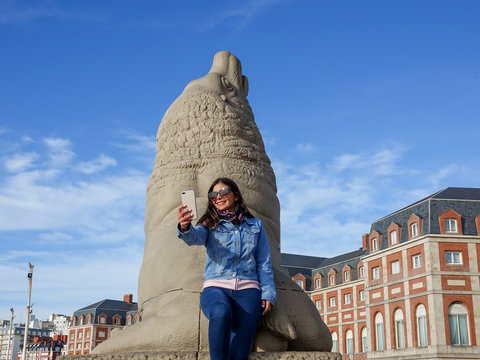 Young girl taking a selfie in Mar del Plata, Buenos Aires, Argentina