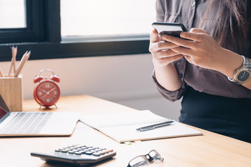 Businesswoman investment consultant analyzing company annual financial report balance sheet statement working with documents graphs. Concept picture of business, market, office, tax.