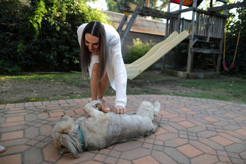 Simah Herman, 18, plays with her dog at her North Hollywood home, Los Angeles