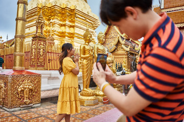 thai tourists taking photos in front of  Wat Phrathat Doi Suthep temple near chiang mai thailand