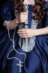 Renaissance woman in blue silk dress