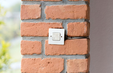 Lightswitch in a brick wall