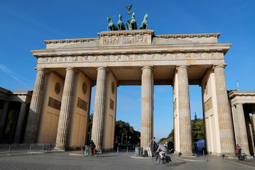 The moon is seen above the Quadriga of the Brandenburg Gate in Berlin