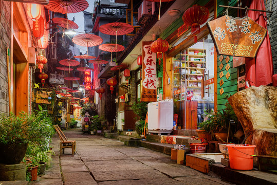 Scenic narrow street of Phoenix Ancient Town (Fenghuang), China