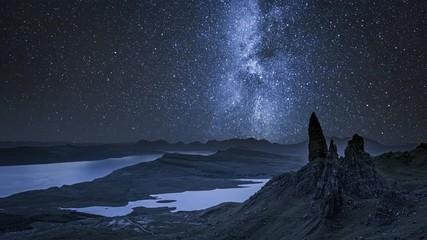 Fototapete - Milky way over Old Man of Storr at night, Scotland,UK