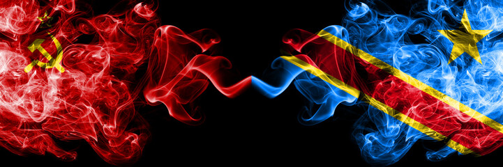 Communist vs Democratic Republic of the Congo abstract smoky mystic flags placed side by side. Thick colored silky smoke flags of Communism and Democratic Republic of the Congo