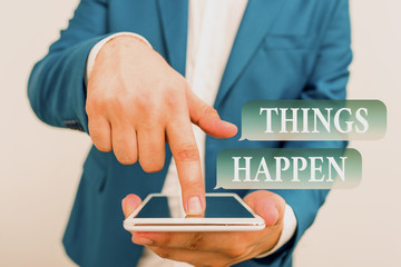Text sign showing Things Happen. Business photo showcasing Result of situation Course of action Something cannot control Businessman in the blue suite with lap top pointing with finger
