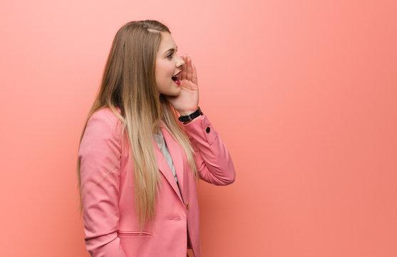 Young russian woman wearing pajama whispering gossip undertone