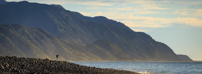 Person standing at lake with Kaikoura Seaward Range, Kaikoura South Island New Zealand