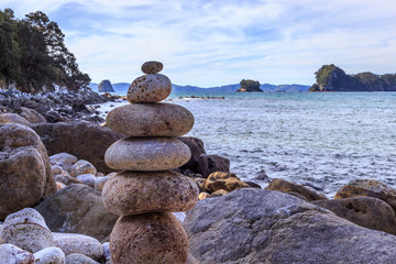 Poster Cathedral Cove stack of stones on beach at Cathedral Cover North Island New Zealand
