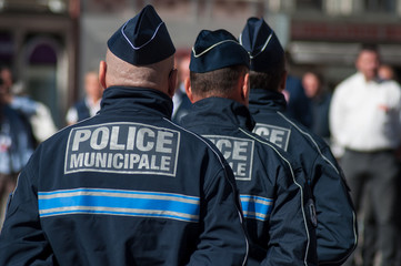 Portrait of policemen standing on the main place during  the Thirtieth anniversary ceremony of the creation of the municipal police