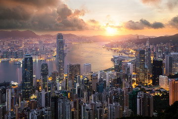 Sunrise over Hong Kong Victoria Harbor from Victoria Peak with Hong Kong and Kowloon below. Asian tourism, modern city life, or business finance and economy concept.