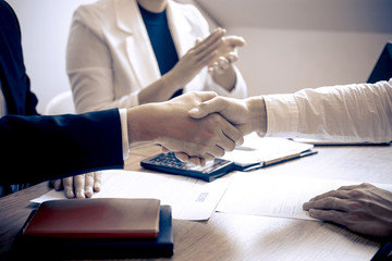Successful job interview, Image of Boss employer committee or recruiter in suit and new employee shaking hands and clap after good deal negotiation interviewing, career and placement concept