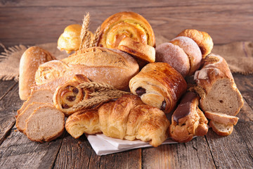 assorted of pastry- croissant, chocolate pastry and bread