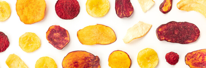 Foto op Plexiglas Keuken Dry fruit and vegetable chips overhead panoramic shot. Healthy vegan snack, an organic food flat lay pattern on a white background