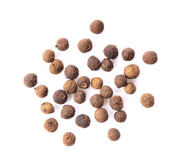 Fototapeta Allspice berries (also called Jamaican pepper or newspice) over white background. top view obraz