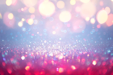 Fotomurales - Christmas Glittering - Red And Blue Defocused Dust With Orange Bokeh Lights