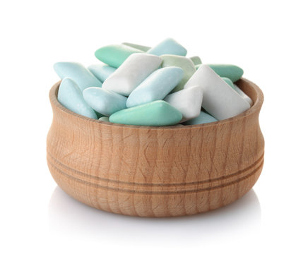 Wooden bowl of mint chewing gum pieces