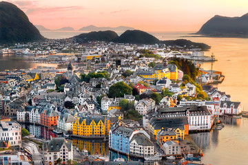 Alesund is a port and tourist city at the entrance to the Geirangerfjord.