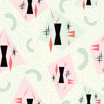 Mid century modern seamless pattern inspired from 1950's atomic poster art. Pale yellow background with pink, green, coral and black. For textiles, graphic design, fashion, paper items, gift wrapping.