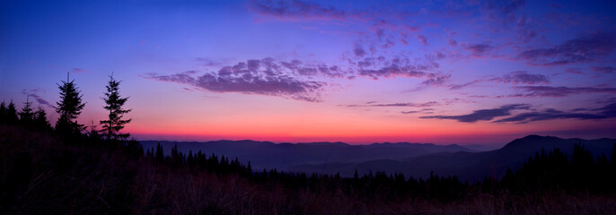 Colorful skyline over the mountains in early morning before sunrise