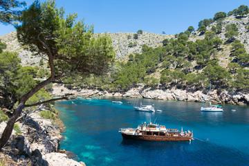 island of Mallorca. Pleasure ship and yachts in the Bay of Cala Murta