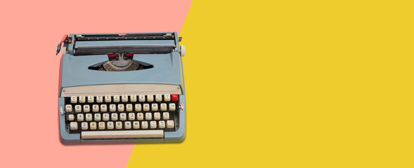 Vintage typewriter over a pastel background with copy space banner