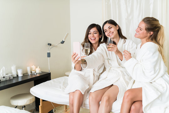 Caucasian Female Friends Posing For Woman At Spa