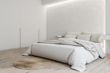 Corner of white master bedroom with wardrobe
